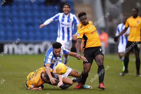 Kurtis Guthrie of Colchester United looks to get past Mark O'Brien of Newport County and Tyler Reid of Newport County - Colchester United v Newport County, Sky Bet League Two, Weston Homes Community Stadium, Colchester - 3rd February 2018.