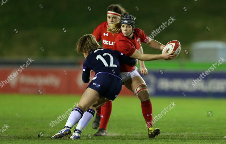 Beth Lewis of Wales is tackled by Lisa Martin of Scotland.