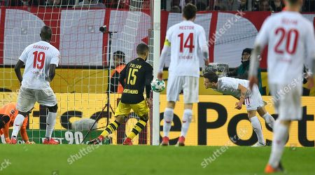 Cologne's Simon Zoller, right, heads his side's first goal during the German Bundesliga soccer match between 1. FC Cologne and Borussia Dortmund in Cologne, Germany