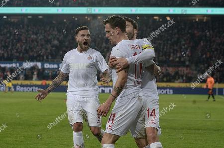 Football : Germany -1. Bundesliga  2017/18  1. FC Koeln Vs Borussia Dortmond 02/02/2018 - Simon Zoller (1. FC Koeln) celebrates scoring a goal with his team. Marco Hoeger (1. FC Koeln), Jonas Hector (1. FC Koeln)