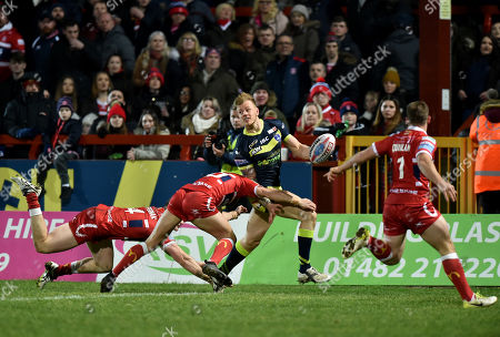 Stock Image of Wakefield Trinity Wildcats Tom Johnstone is tackled by Andrew Heffernan of Hull KR and Matty Marsh of Hull KR