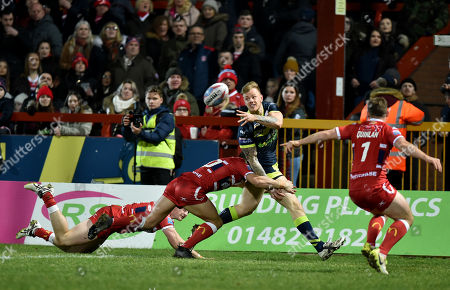 Stock Picture of Wakefield Trinity Wildcats Tom Johnstone is tackled by Andrew Heffernan of Hull KR and Matty Marsh of Hull KR
