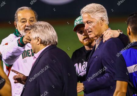 Bill Clinton, Saul Canelo Alvarez, Carlos Slim. Mexican boxer Saul Canelo Alvarez, right rear, puts his arm around former U.S. President Bill Clinton as they stand with Mexican businessmen Carlos Slim, left rear, and Carlos Bremer during the opening ceremony of the Caribbean Series baseball tournament in Guadalajara, Mexico