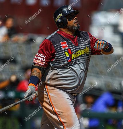 Luis Jimenez of Venezuela's Caribes de Anzoategui watches his home run hit in their game against Cuba's Alazanes de Granma, during the Caribbean Series baseball tournament, in Guadalajara, Mexico, on