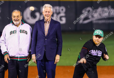 Carlos Slim, Bill Clinton, Saul Canelo Alvarez. Former U.S. President Bill Clinton, center, and Mexican billionaire Carlos Slim, left, watch as Mexican boxer Saul Canelo Alvarez throws out the first pitch during the opening ceremony of the Caribbean Series baseball tournament in Guadalajara, Mexico