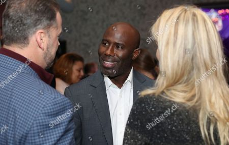Terrell Davis talks to guests at the NFLN Super Bowl LII media party, in Minneapolis