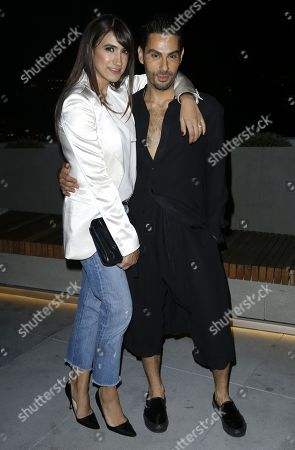 Stock Photo of Mandana Dayani, Joey Maalouf. Mandana Dayani, left, and Joey Maalouf attend the Celebration of The Glam App's Re-launch at The Jeremy hotel, in West Hollywood, Calif