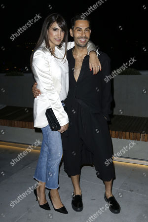 Stock Picture of Mandana Dayani, Joey Maalouf. Mandana Dayani, left, and Joey Maalouf attend the Celebration of The Glam App's Re-launch at The Jeremy hotel, in West Hollywood, Calif