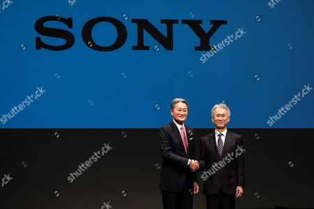 Stock Image of Outgoing Sony Corp. President Kazuo Hirai (L) and newly appointed President Kenichiro Yoshida (R) attend a press conference at the company's headquarters in Tokyo