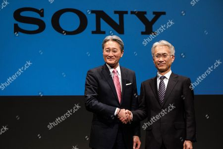 Stock Picture of Outgoing Sony Corp. President Kazuo Hirai (L) and newly appointed President Kenichiro Yoshida (R) attend a press conference at the company's headquarters in Tokyo