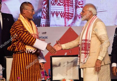 Bhutan's Prime Minister Tshering Tobgay, left, and Indian Prime Minister Narendra Modi greet each other at the inaugural function of Advantage Assam Global Investor's Summit 2018 in Gauhati, India, . Advantage Assam - Global Investors' Summit is the largest investment promotion and facilitation initiative by the Government of Assam, to highlight geo-strategic advantages of Assam where 16 countries are participating