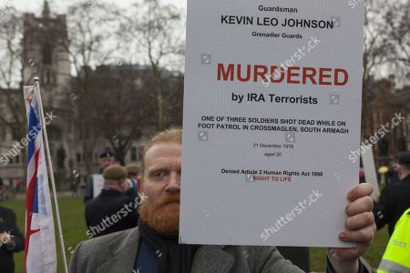 14666198753 Northern Ireland Veteran holding a sign with the names og soldiers killed  by IRA terrorists