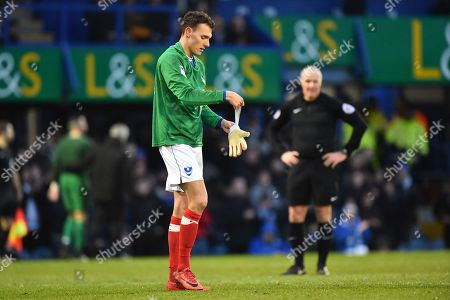 Kal Naismith (22) of Portsmouth replaces goalkeeper Stephen Henderson (13) of Portsmouth who went off injured during the EFL Sky Bet League 1 match between Portsmouth and Doncaster Rovers at Fratton Park, Portsmouth. Picture by Graham Hunt