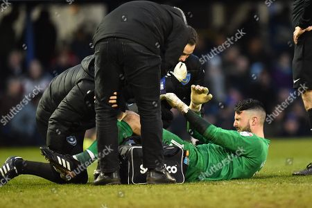 Stephen Henderson (13) of Portsmouth in pain after picking up a thigh injury which forced him off and he was replaced by Kal Naismith (22) of Portsmouth during the EFL Sky Bet League 1 match between Portsmouth and Doncaster Rovers at Fratton Park, Portsmouth. Picture by Graham Hunt