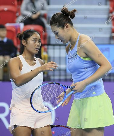 Stock Photo of Yafan Wang (L) and Ying-Ying Duan of China reacts during their women's doubles match  against Kai-Chen Chang and Chia-Jung Chuang of Taiwan at the WTA Taiwan Open tennis tournament in Taipei, Taiwan, 03 February 2018.