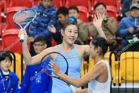 Stock Image of Ying-Ying Duan (L) and Yafan Wang of China celebrate winning their women's doubles match against Kai-Chen Chang and Chia-Jung Chuang of Taiwan at the WTA Taiwan Open tennis tournament in Taipei, Taiwan, 03 February 2018.