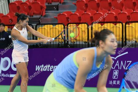 Yafan Wang (L) and Ying-Ying Duan of China in action during their women's doubles match  against Kai-Chen Chang and Chia-Jung Chuang of Taiwan at the WTA Taiwan Open tennis tournament in Taipei, Taiwan, 03 February 2018.