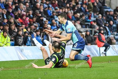 Carlisle United Defender Clint Hill (29) and Wycombe Wanderers Midfielder Matthew Bloomfield (10) battle for the ball during the EFL Sky Bet League 2 match between Wycombe Wanderers and Carlisle United at Adams Park, High Wycombe. Picture by Stephen Wright