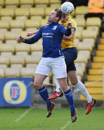 Sean McGinty of Torquay United challenges for the ariel ball with Grant Holt of Barrow during the Vanarama National League match between Torquay United and Barrow at Plainmoor, Torquay, Devon on February 03