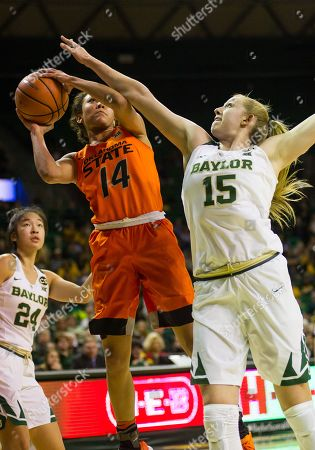 Oklahoma State Cowgirls guard Braxtin Miller (14) goes up for a shot against Baylor Bears forward Lauren Cox (15) during the 1st half of the NCAA Basketball game between the Oklahoma State Cowgirls and Baylor Bears at the Ferrell Center in Waco, Texas