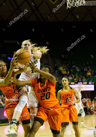 Baylor Bears forward Lauren Cox (15) fights for a rebound against Oklahoma State Cowgirls forward LaTashia Jones (20) and Oklahoma State Cowgirls guard Braxtin Miller (14) during the 2nd half of the NCAA Basketball game between the Oklahoma State Cowgirls and Baylor Bears at the Ferrell Center in Waco, Texas