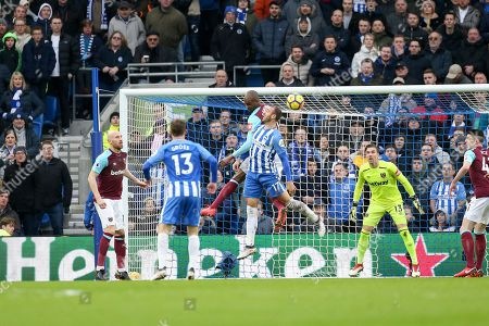 Brighton and Hove Albion forward Glenn Murray (17) battles in the air for header with West Ham United defender Winston Reid (2) during the Premier League match between Brighton and Hove Albion and West Ham United at the American Express Community Stadium, Brighton and Hove. Picture by Phil Duncan