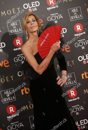 Spanish actress Bibiana Fernandez poses with a fan that reads #MOREWOMEN as she arrives at the 32nd Goya Awards, celebrated at the Marriott Auditorium Hotel, in Madrid, Spain, 03 February 2018.