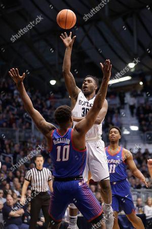 Tre'Darius McCallum, Kelan Martin. Butler forward Kelan Martin (30) shoots over DePaul forward Tre'Darius McCallum (10) in the first half of an NCAA college basketball game in Indianapolis, . Butler defeated DePaul 80-57