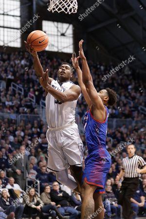 Eli Cain, Kelan Martin. Butler forward Kelan Martin (30) shoots in front of DePaul guard Eli Cain (11) in the first half of an NCAA college basketball game in Indianapolis