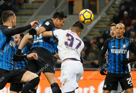 Inter Milan's Citadin Martins Eder jumps higher than Crotone's Davide Faraoni to score his side's first goal during an Italian Serie A soccer match between Inter Milan and Crotone, at the San Siro stadium in Milan, Italy