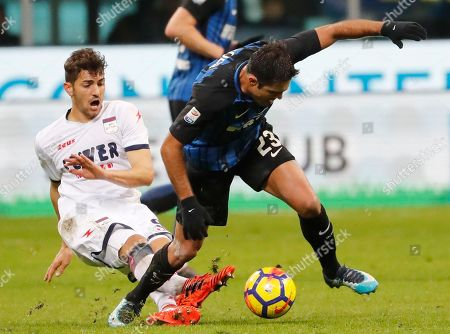 Crotone's Andrea Nalini tackles Inter Milan's Citadin Martins Eder during an Italian Serie A soccer match between Inter Milan and Crotone, at the San Siro stadium in Milan, Italy