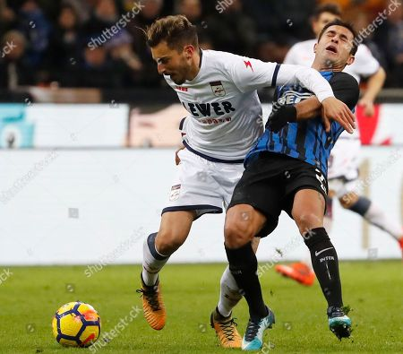 Crotone's Federico Ceccherini, left, and Inter Milan's Citadin Martins Eder vie for the ball during an Italian Serie A soccer match between Inter Milan and Crotone, at the San Siro stadium in Milan, Italy