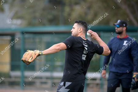 Omar Infante, Ernesto Mejia. Professional baseball players Omar Infante, left, and Ernesto Mejia throw while training at the Tom Shaw performance camp, in Lake Buena Vista, Fla