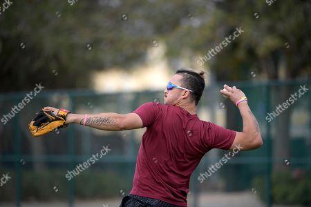 Professional baseball player Hernan Perez throws while training at the Tom Shaw performance camp, in Lake Buena Vista, Fla