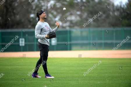 Professional baseball player Carlos Gonzalez throws while training at the Tom Shaw performance camp, in Lake Buena Vista, Fla