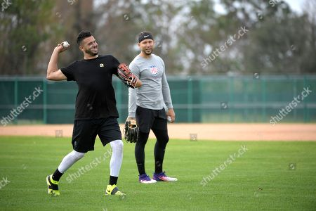 Edwin Rios, Carlos Gonzalez. Professional baseball players Edwin Rios, left, and Carlos Gonzalez throw while training at the Tom Shaw performance camp, in Lake Buena Vista, Fla