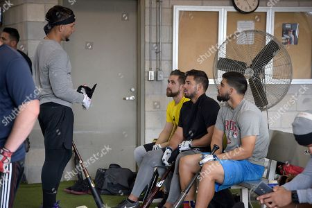 Ender Inciarte, Vincente Conde, Mauro Conde, Carlos Gonzalez. Professional baseball players Carlos Gonzalez, left, chats with Ender Inciarte, second from left, Vincente Conde, and Mauro Conde, right, during batting practice while training at the Tom Shaw performance camp, in Lake Buena Vista, Fla
