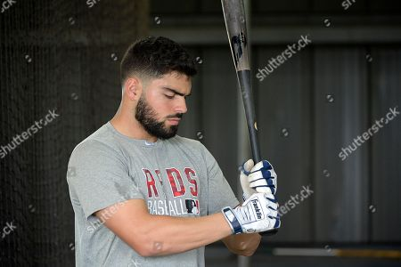 Professional baseball player Mauro Conde waits to hit during batting practice while training at the Tom Shaw performance camp, in Lake Buena Vista, Fla