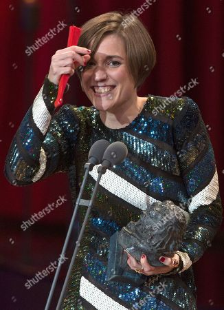 Carla Simon holds a fan and her Goya after winning the Best new director award for the film Verano 1993 during the Goya Film Awards Ceremony in Madrid, Spain