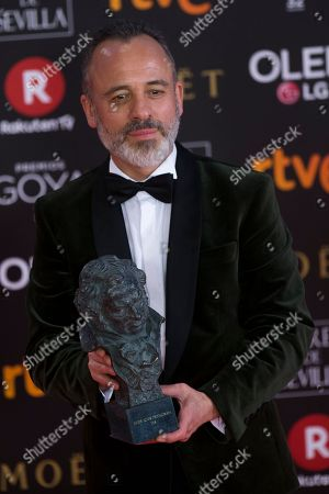 """Spanish actor Javier Gutierrez poses with his trophy after winning the best leading actor award for his role in the film """"El Autor"""" during the Goya Film Awards Ceremony in Madrid, Saturday, Feb, 3, 2018"""