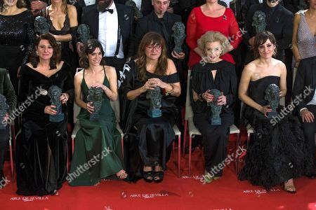Nathalie Poza, Marisa Paredes, Isabel Coixet, Bruna Cosi, Adelfa Calvo. Spanish actress Nathalie Poza, Marisa Paredes, filmmaker Isabel Coixet, Bruna Cosi and Adelfa Calvo, front right to left, pose with their trophies at the end of the the Goya Film Awards Ceremony in Madrid, Saturday, Feb, 3, 2018