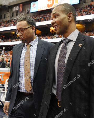 Virginia Cavalier assistant coach Jason Williford and Virginia Cavalier associate head coach Ron Sanchez walk onto the court prior to Virginia defeating Syracuse 59-44 in front of 27,083 fans in an ACC matchup at the Carrier Dome in Syracuse, NY