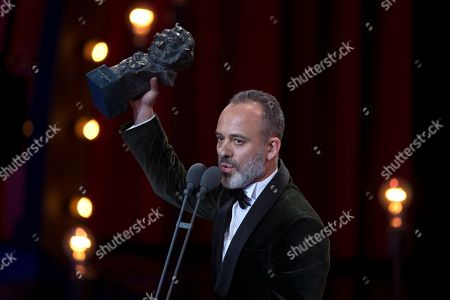 Javier Gutierrez raises the Goya award after winning Best leading actor prize for the film El Autor during the Goya Film Awards Ceremony in Madrid, Spain