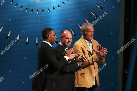 Cris Carter, Rich Eisen, Brett Favre. Rich Eisen, center, and former NFL players Cris Carter and Brett Favre on stage at the 7th Annual NFL Honors at the Cyrus Northrop Memorial Auditorium, in Minneapolis, Minnesota