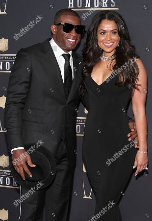 Deion Sanders,Tracey Edmonds. Former NFL player Deion Sanders, right, and Tracey Edmonds arrives at the 7th Annual NFL Honors at the Cyrus Northrop Memorial Auditorium, in Minneapolis, Minnesota