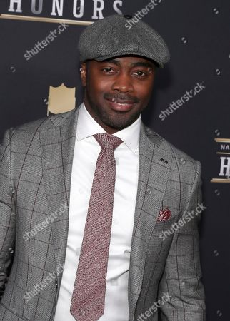 Former NFL player Curtis Martin arrives at the 7th Annual NFL Honors at the Cyrus Northrop Memorial Auditorium, in Minneapolis, Minnesota