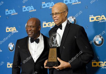 John Singleton, Dwight Williams. John Singleton, left, poses with Dwight Williams, winner of the Frank Capra achievement award