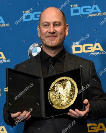"""Martin de Thurah poses in the press room with the award for outstanding directorial achievement in commercials for """"Festival"""" and """"Machines"""" for StubHub and """"Mad World"""" for WealthSimple"""