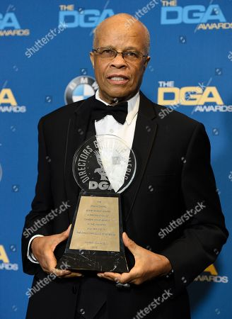 Stock Photo of Dwight Williams poses in the press room with the Frank Capra achievement award