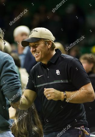 Chip Gaines shakes a fan's hand at the end of the 2nd half of the NCAA Basketball game between the Iowa State Cyclones and Baylor Bears at the Ferrell Center in Waco, Texas